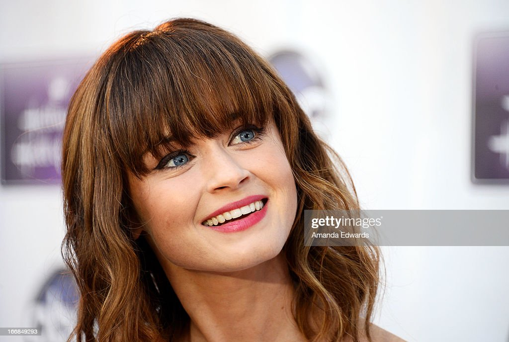 Actress Alexis Bledel arrives at the Disney ABC Television and The Hallmark Hall of Fame's premiere of 'Remembering Sunday' at Fox Studio Lot on April 17, 2013 in Century City, California.