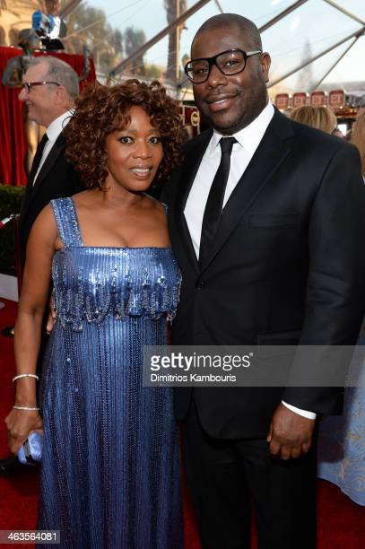 Actress Alfre Woodard and director Steve McQueen attend 20th Annual Screen Actors Guild Awards at The Shrine Auditorium on January 18 2014 in Los...