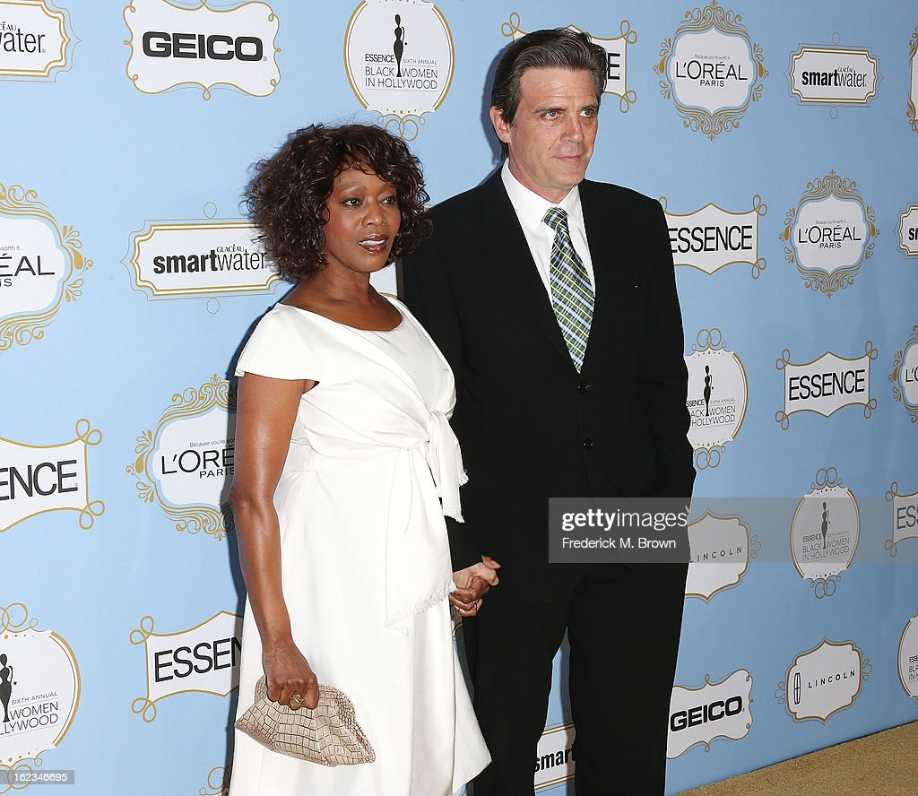 Actress <a gi-track='captionPersonalityLinkClicked' href=/galleries/search?phrase=Alfre+Woodard&family=editorial&specificpeople=220969 ng-click='$event.stopPropagation()'>Alfre Woodard</a> (L) and Roderick Spencer attend the Sixth Annual ESSENCE Black Women In Hollywood Awards Luncheon at the Beverly Hills Hotel on February 21, 2013 in Beverly Hills, California.