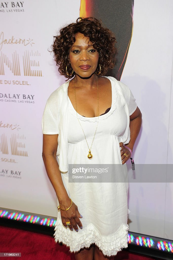 Actress <a gi-track='captionPersonalityLinkClicked' href=/galleries/search?phrase=Alfre+Woodard&family=editorial&specificpeople=220969 ng-click='$event.stopPropagation()'>Alfre Woodard</a> arrives at the world premiere of 'Michael Jackson ONE by Cirque du Soleil' at THEhotel at Mandalay Bay on June 29, 2013 in Las Vegas, Nevada.