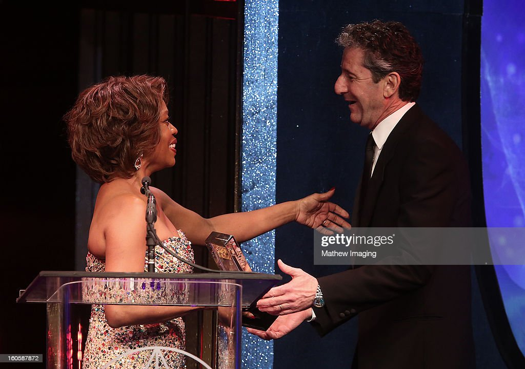 Actress Alfre Woodard presents Production Designer David Gropman the award for Excellence in Production Design for a Fantasy Feature Film 2012 - LIFE OF PI onstage at The 17th Annual Art Directors Guild Awards, held at the Beverly Hilton Hotel on February 2, 2013 in Beverly Hills, California.