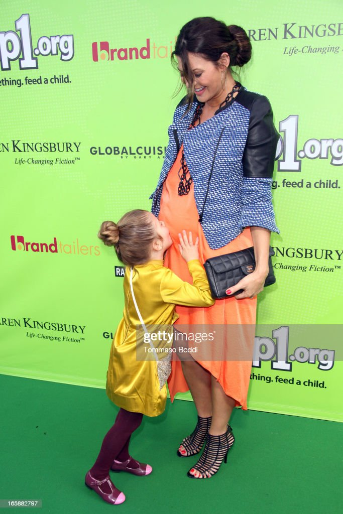 Actress <a gi-track='captionPersonalityLinkClicked' href=/galleries/search?phrase=Ali+Landry&family=editorial&specificpeople=543155 ng-click='$event.stopPropagation()'>Ali Landry</a> (R) and daughter Estela Ines attend the Skip1.org's 'Skip And Donate' gala event held at The Lot on April 6, 2013 in West Hollywood, California.