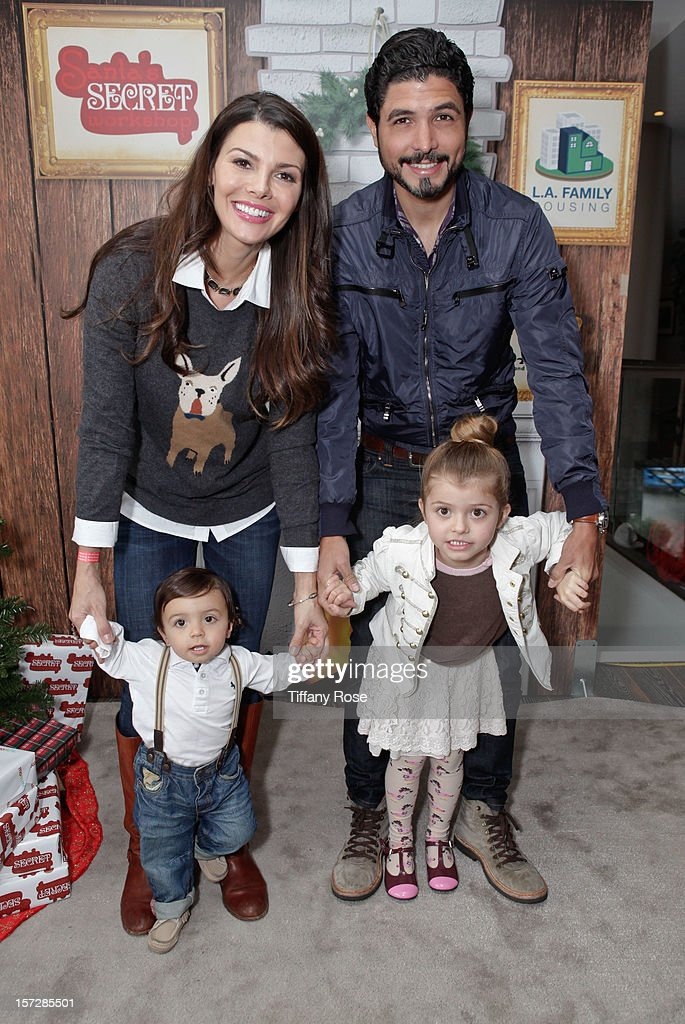 Actress <a gi-track='captionPersonalityLinkClicked' href=/galleries/search?phrase=Ali+Landry&family=editorial&specificpeople=543155 ng-click='$event.stopPropagation()'>Ali Landry</a>, husband Alejandro Gomez, son Marcelo Alejandro and daughter Estella attend the 2nd Annual Santa's Secret Workshop Benefiting L.A. Family Housing at Andaz on December 1, 2012 in West Hollywood, California.