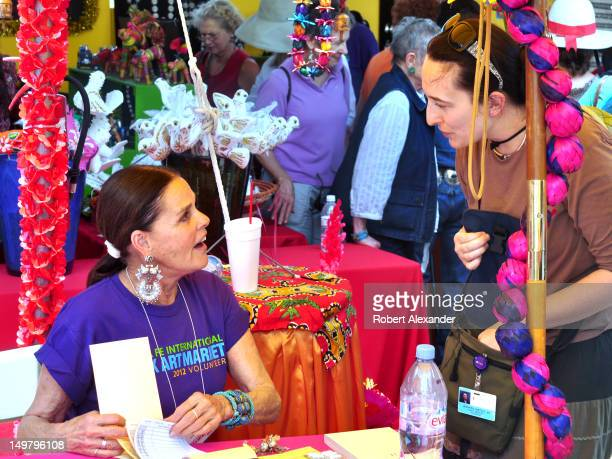 Actress Ali MacGraw left talks with a friend at the 2012 Santa Fe International Folk Art Market MacGraw was a volunteer salesperson at the annual...