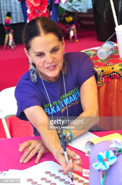 Actress Ali MacGraw serves as a volunteer salesperson at the 2012 Santa Fe International Folk Art Market The actress lives in Santa Fe New Mexico and...