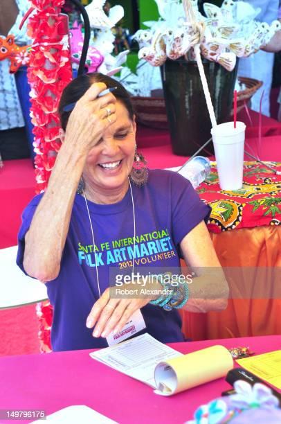 Actress Ali MacGraw works as a volunteer salesperson at the 2012 Santa Fe International Folk Art Market The actress who lives in Santa Fe New Mexico...