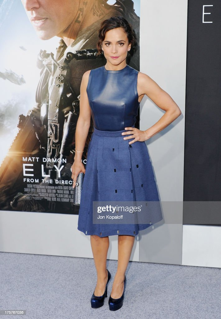Actress Alice Braga arrives at the Los Angeles Premiere 'Elysium' at Regency Village Theatre on August 7, 2013 in Westwood, California.