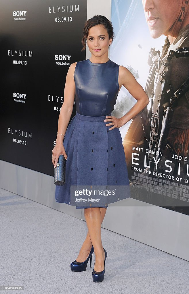 Actress Alice Braga arrives at the Los Angeles premiere of 'Elysium' at Regency Village Theatre on August 7, 2013 in Westwood, California.