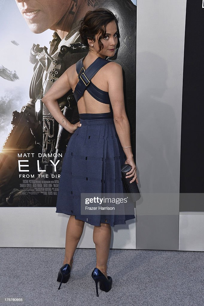 Actress Alice Braga arrives at the premiere of TriStar Pictures' 'Elysium' at Regency Village Theatre on August 7, 2013 in Westwood, California.