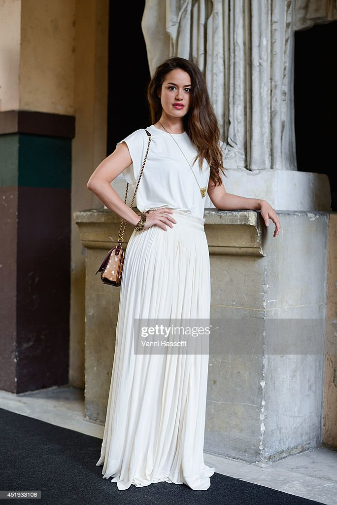 Actress Alice David poses wearing a Vionnet dress before Vionnet show on July 9, 2014 in Paris, France.
