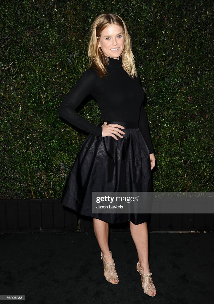 Actress Alice Eve attends the Chanel and Charles Finch pre-Oscar dinner at Madeo Restaurant on March 1, 2014 in Los Angeles, California.