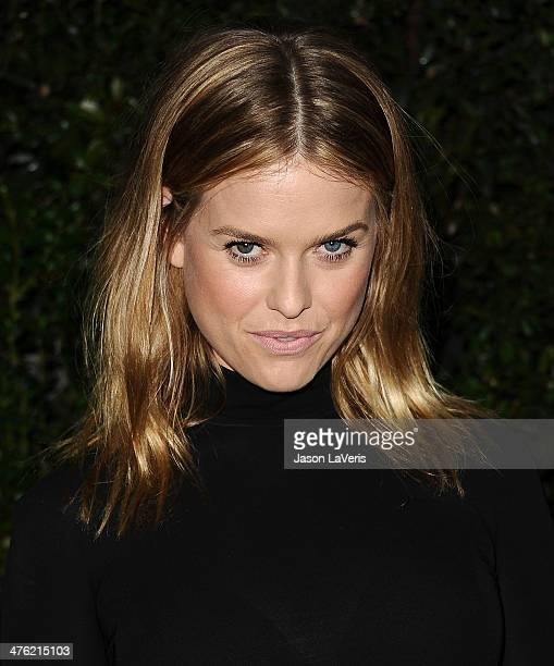 Actress Alice Eve attends the Chanel and Charles Finch preOscar dinner at Madeo Restaurant on March 1 2014 in Los Angeles California