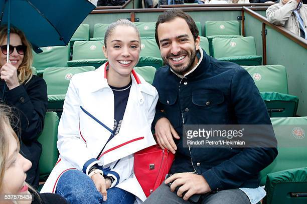 Actress Alice Isaaz and guest attend Day Twelve of the 2016 French Tennis Open at Roland Garros on June 2 2016 in Paris France