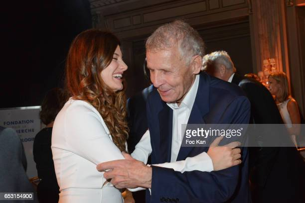 Actress Alice Pol and TV presenter Patrick Poivre D'Arvor attend 'La Recherche en Physiologie' Charity Gala at Four Seasons Hotel George V on March...