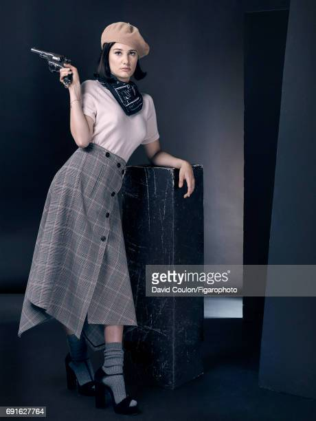Actress Alice Pol is photographed as Bonnie Parker for Madame Figaro on April 3 2017 in Paris France Sweater shirt beret scarf socks sandals...