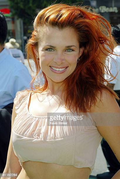 Actress Alicia Arden arrives for the premiere of Warner Bros 'YuGiOh The Movie' at the Chinese Theater August 7 2004 in Los Angeles California