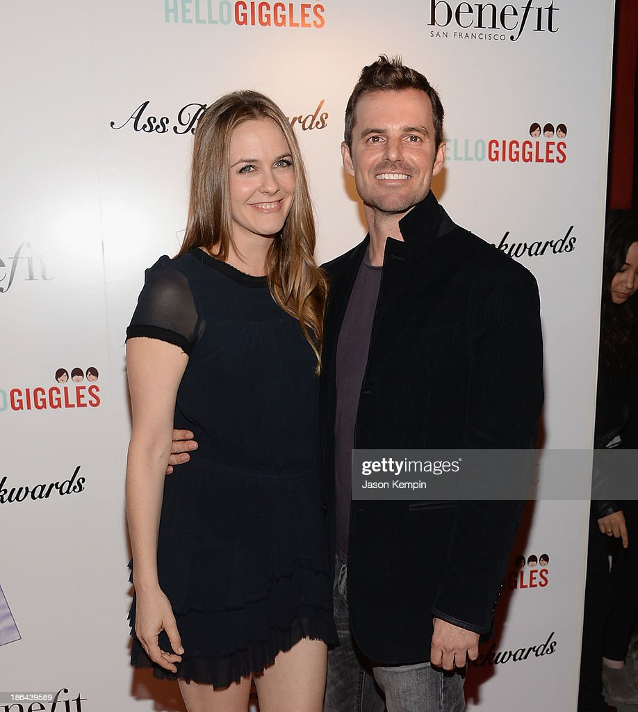 Actress Alicia Silverstone and director Chris Nelson attend the premiere of Gravitas Ventures' 'Ass Backwards' at the Vista Theatre on October 30, 2013 in Los Angeles, California.