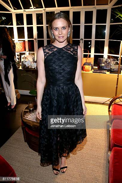 Actress Alicia Silverstone attends a dinner for the launch of the first luxury handbag collection by Christian Siriano at Chateau Marmont on February...