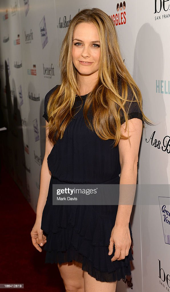 Actress Alicia Silverstone attends the premiere of Gravitas Ventures' 'Ass Backwards' at the Vista Theatre on October 30, 2013 in Los Angeles, California.