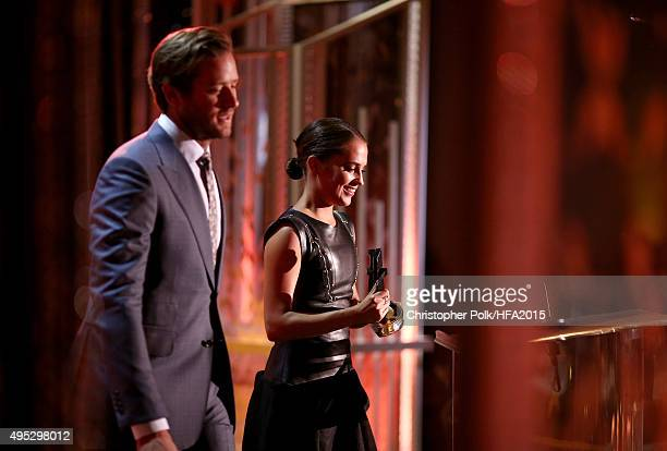 Actress Alicia Vikander accepts the Hollywood Breakout Actress Award for 'The Danish Girl' from actor Armie Hammer onstage during the 19th Annual...