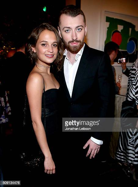 Actress Alicia Vikander and recording artist Sam Smith attend The Hollywood Reporter's 4th Annual Nominees Night at Spago on February 8 2016 in...