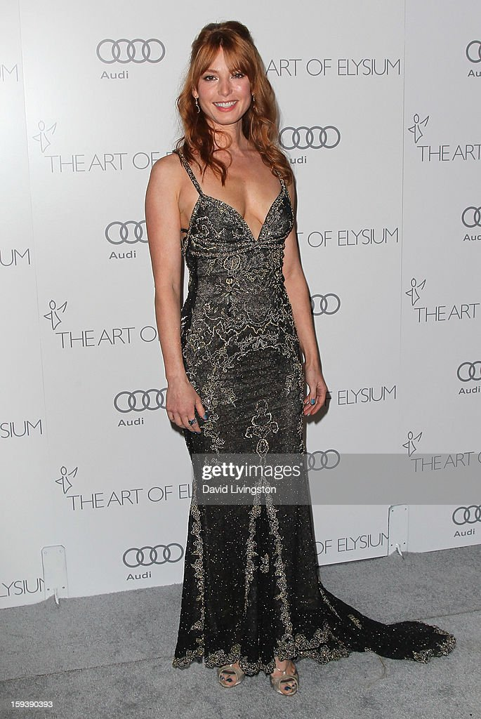 Actress Alicia Witt attends the Art of Elysium's 6th Annual Black-tie Gala 'Heaven' at 2nd Street Tunnel on January 12, 2013 in Los Angeles, California.