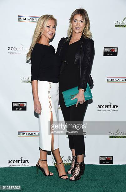Actress Alison Doody and her daughter arrive at the 2016 Oscar Wilde Awards at Bad Robot on February 25 2016 in Santa Monica California