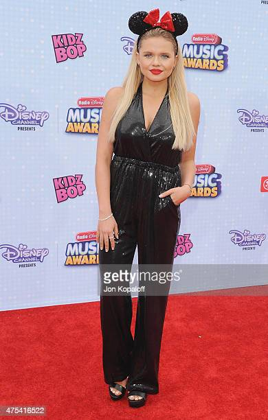 Actress Alli Simpson arrives at the 2015 Radio Disney Music Awards at Nokia Theatre LA Live on April 25 2015 in Los Angeles California