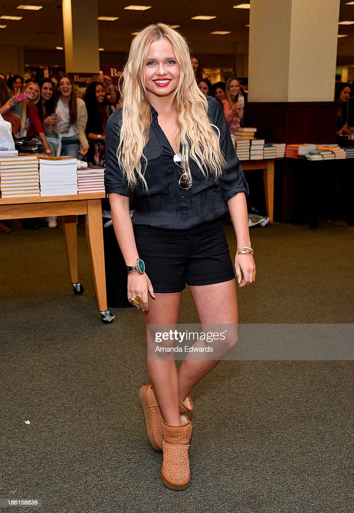 Actress Alli Simpson attends the book signing of her brother, singer Cody Simpson's new book 'Welcome To Paradise' at Barnes & Noble bookstore at The Grove on October 28, 2013 in Los Angeles, California.