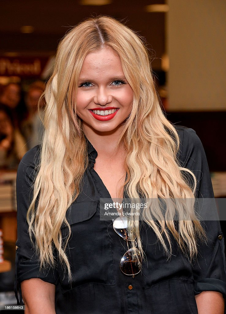 Actress <a gi-track='captionPersonalityLinkClicked' href=/galleries/search?phrase=Alli+Simpson&family=editorial&specificpeople=7439624 ng-click='$event.stopPropagation()'>Alli Simpson</a> attends the book signing of her brother, singer Cody Simpson's new book 'Welcome To Paradise' at Barnes & Noble bookstore at The Grove on October 28, 2013 in Los Angeles, California.