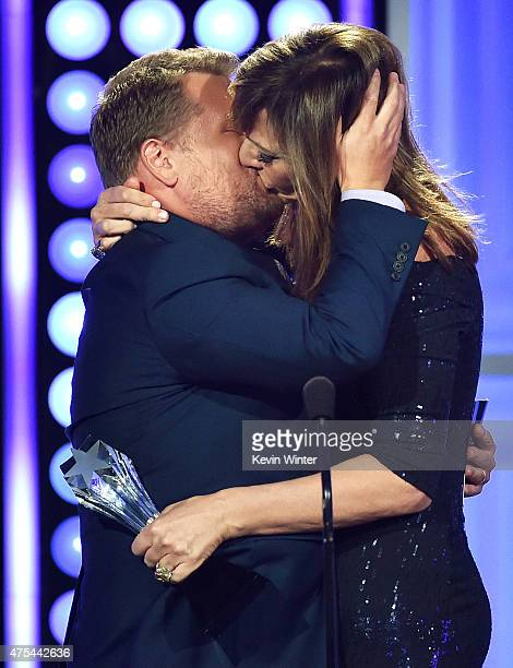 Actress Allison Janney accepts the Best Supporting Actress award for 'Mom' from tv personality James Corden onstage at the 5th Annual Critics' Choice...