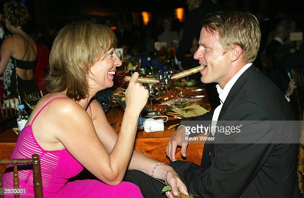 Actress Allison Janney and actor Richard Jenik mingle during the Governor's Ball after the 55th Annual Emmy Awards at the Shrine Auditorium September...