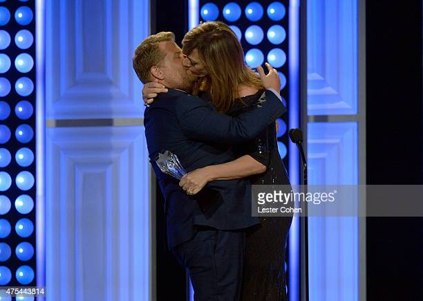 Actress Allison Janney kisses comedian/TV personality James Corden while accepting the Best Supporting Actress award for 'Mom' onstage at the 5th...
