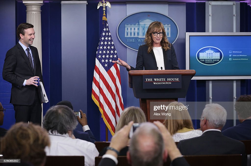 Actress <a gi-track='captionPersonalityLinkClicked' href=/galleries/search?phrase=Allison+Janney&family=editorial&specificpeople=206290 ng-click='$event.stopPropagation()'>Allison Janney</a> (R) speaks as she shows up to surprise members of the press crops at the James Brady Press Briefing Room of the White House as press secretary <a gi-track='captionPersonalityLinkClicked' href=/galleries/search?phrase=Josh+Earnest&family=editorial&specificpeople=6990565 ng-click='$event.stopPropagation()'>Josh Earnest</a> (L) looks on April 29, 2016 in Washington, DC. Janney, who was known to viewers as White House press secretary C.J. Cregg in the drama series The West Wing, was in town to call for attention on the opioid epidemic.