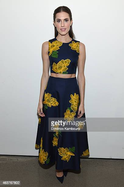 Actress Allison Williams poses backstage at the Michael Kors fashion show during MercedesBenz Fashion Week Fall 2015 at Spring Studios on February 18...