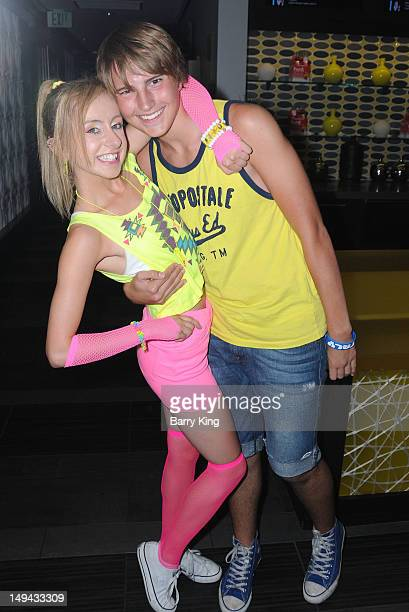 Actress Allisyn Ashley Arm and actor Drew Patrick attend Sterling Beaumon's Summer Bash on July 27 2012 in Hollywood California