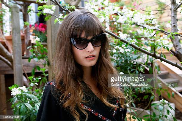 Actress Alma Jodorowsky is photographed for Madame Figaro on April 8 2012 in Paris France Figaro ID 103704008 Jacket by Chanel sunglasses by Jimmy...