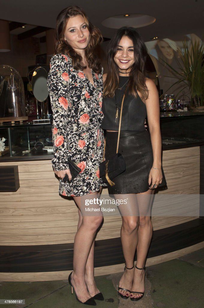 Actress Aly Michalka and Vanessa Hudgens pose at Alessandra Ambrosio Launch of 'ale by Alessandra' at Planet Blue in Beverly Hills on March 13, 2014 in Los Angeles, California.