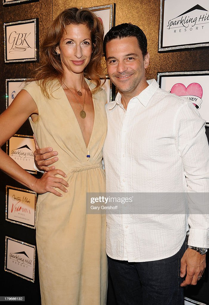 Actress <a gi-track='captionPersonalityLinkClicked' href=/galleries/search?phrase=Alysia+Reiner&family=editorial&specificpeople=655685 ng-click='$event.stopPropagation()'>Alysia Reiner</a> and actor <a gi-track='captionPersonalityLinkClicked' href=/galleries/search?phrase=David+Alan+Basche&family=editorial&specificpeople=612876 ng-click='$event.stopPropagation()'>David Alan Basche</a> pose at the GBK & Sparkling Resort Fashionable Lounge during Mercedes-Benz Fashion Week on September 6, 2013 in New York City.