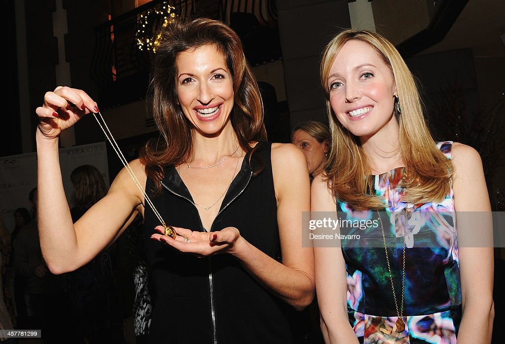 Actress Alysia Reiner and designer Suz Somersall attend the 'Orange Is The New Black - My Year In Women's Prison' charity book shopping experience at Carlton Hotel on December 18, 2013 in New York City.