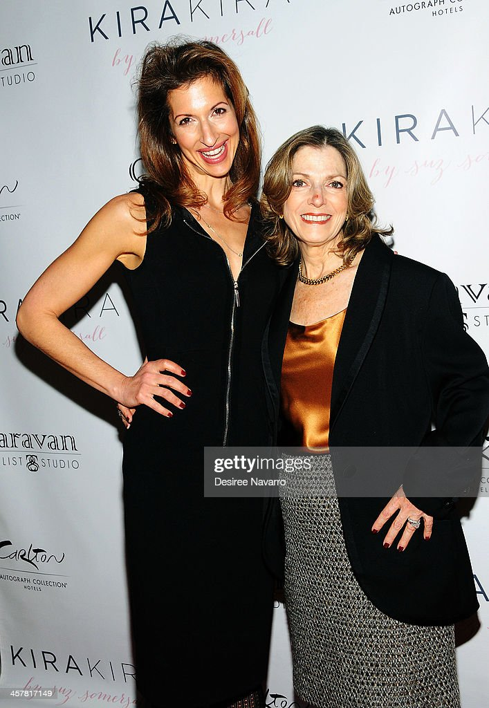Actress Alysia Reiner (L) and her mother Terry Berenson attend the 'Orange Is The New Black - My Year In Women's Prison' charity book shopping experience at Carlton Hotel on December 18, 2013 in New York City.
