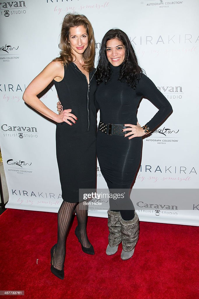 Actress Alysia Reiner and Laura Gomez attends the 'Orange Is The New Black - My Year In Women's Prison' charity book shopping experience at Carlton Hotel on December 18, 2013 in New York City.