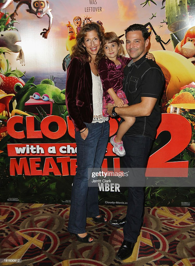 Actress <a gi-track='captionPersonalityLinkClicked' href=/galleries/search?phrase=Alysia+Reiner&family=editorial&specificpeople=655685 ng-click='$event.stopPropagation()'>Alysia Reiner</a> poses with daughter Livia Basche and husband actor <a gi-track='captionPersonalityLinkClicked' href=/galleries/search?phrase=David+Alan+Basche&family=editorial&specificpeople=612876 ng-click='$event.stopPropagation()'>David Alan Basche</a> at The Mom's Screening Of 'Cloudy With A Chance Of Meatballs 2' at AMC Lincoln Square Theater on September 25, 2013 in New York City.