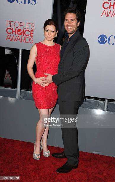 Actress Alyson Hannigan and actor Alexis Denisof arrive at the People's Choice Awards 2012 at Nokia Theatre LA Live on January 11 2012 in Los Angeles...