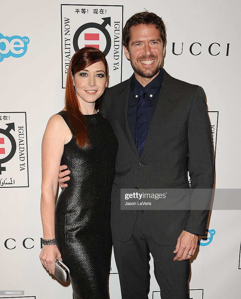 Actress Alyson Hannigan and actor Alexis Denisof attend the 'Make Equality Reality' event at Montage Beverly Hills on November 4, 2013 in Beverly Hills, California.
