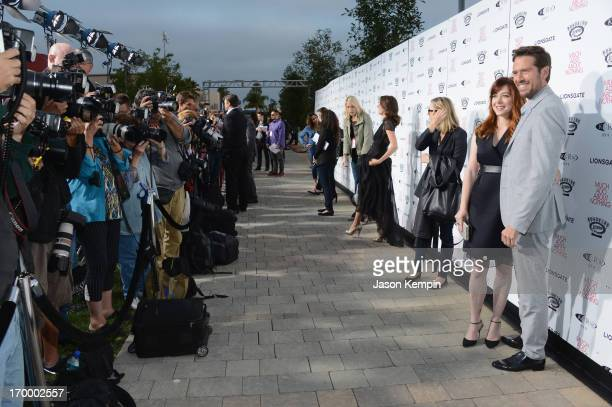 Actress Alyson Hannigan and actor Alexis Denisof attend the screening of Lionsgate and Roadside Attractions' 'Much Ado About Nothing' on June 5 2013...