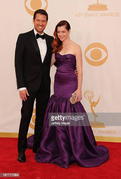 Actress Alyson Hannigan and Alexis Denisof arrive at the 65th Annual Primetime Emmy Awards at Nokia Theatre LA Live on September 22 2013 in Los...