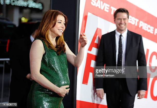 Actress Alyson Hannigan and Alexis Denisof arrive at the Premiere of Universal Pictures' 'American Reunion' at Grauman's Chinese Theatre on March 19...