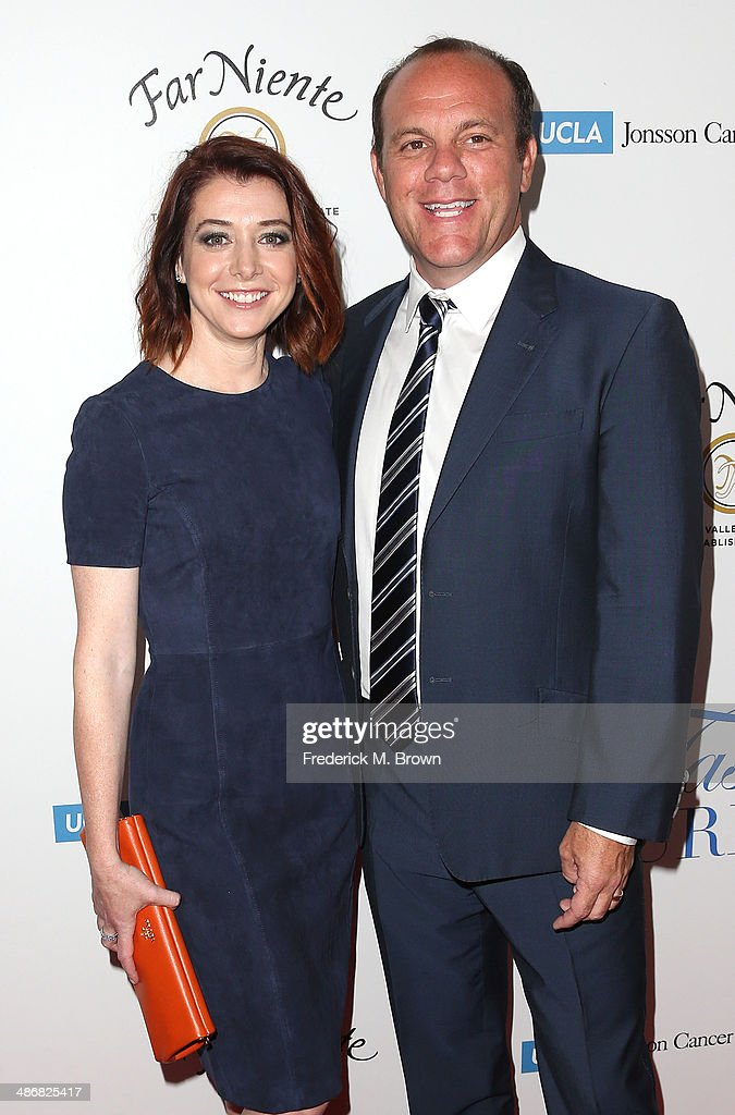 Actress <a gi-track='captionPersonalityLinkClicked' href=/galleries/search?phrase=Alyson+Hannigan&family=editorial&specificpeople=206497 ng-click='$event.stopPropagation()'>Alyson Hannigan</a> (L) and <a gi-track='captionPersonalityLinkClicked' href=/galleries/search?phrase=Tom+Papa&family=editorial&specificpeople=639823 ng-click='$event.stopPropagation()'>Tom Papa</a> attend the Jonsson Cancer Center Foundation's 19th Annual 'Taste for a Cure' at the Regent Beverly Wilshire Hotel on April 25, 2014 in Beverly Hills, California.