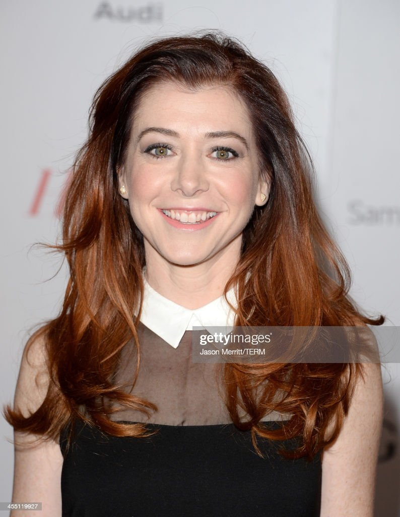 Actress Alyson Hannigan arrives at The Hollywood Reporter's 22nd Annual Women In Entertainment Breakfast at Beverly Hills Hotel on December 11, 2013 in Beverly Hills, California.